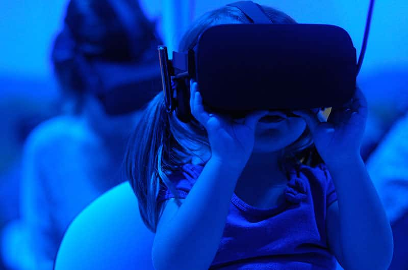 children trying virtual reality in a museum