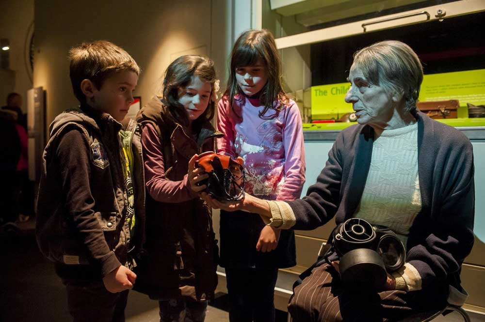children looking at object related to death